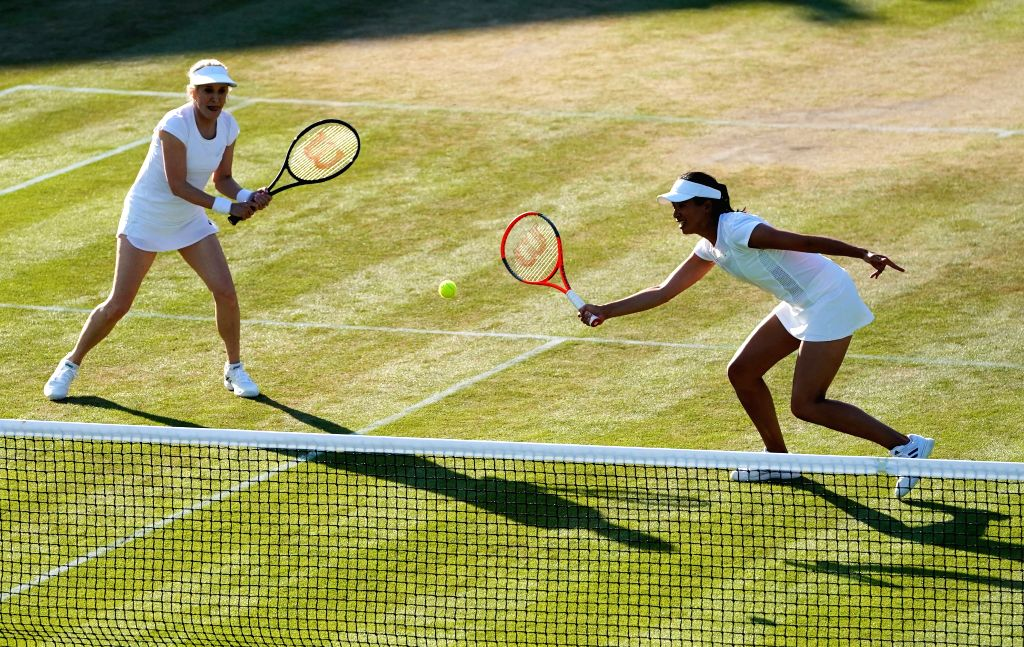 Tracy Austin (L) of the United States and Anne Keothavong of Britain compete during the ladies' invitation doubles third round match against Li Na of China and Ai Sugiyama of Japan at the Wimbledon ...