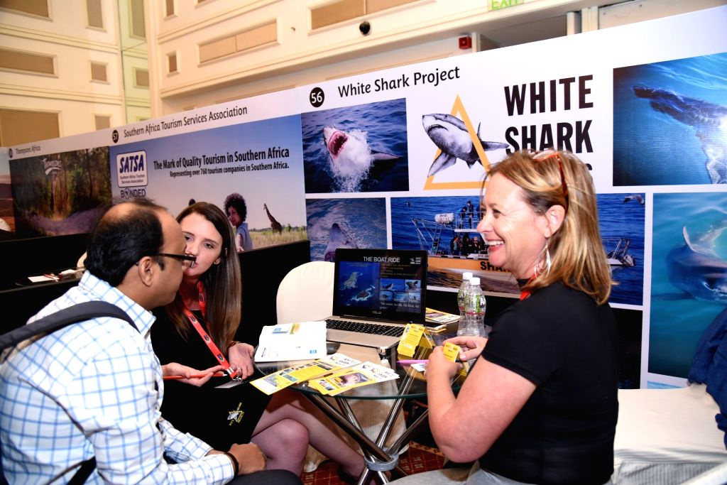 Trade delegates interact with the South African exhibitors at South African Tourism Roadshow 2018 in Mumbai on Feb 13, 2018.