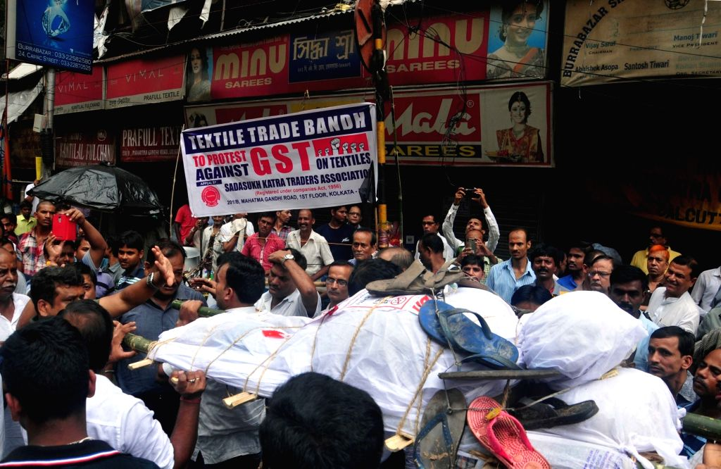 Traders of Kolkata's Burrabazar stage a demonstration against GST in Kolkata, on June 30, 2017.
