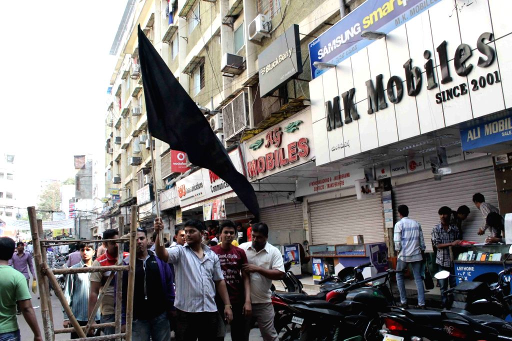 Traders set fire Chief Minister Kiran Kumar Reddy`s effigy in protest against the arrest of MIM Leader Assaduddain Owaisi, MP in Hyderabad.