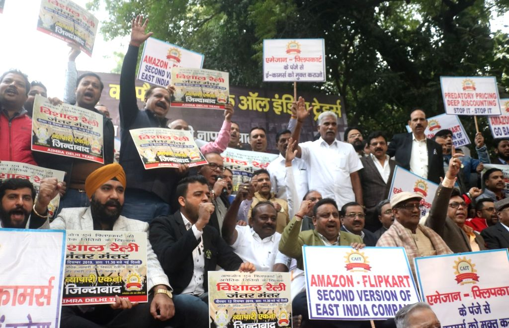 """Traders stage a demonstration against the """"unethical and unfair trade practices"""" of e-commerce firms Flipkart and Amazon, at Jantar Mantar in New Delhi on Dec 12, 2019."""
