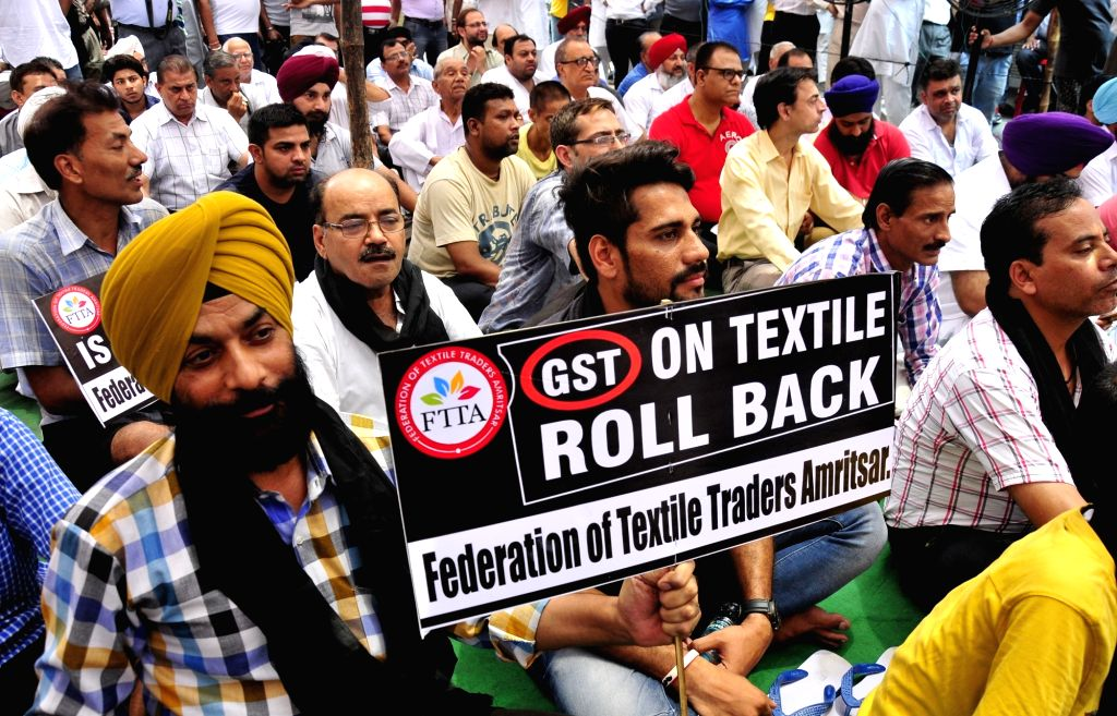 Traders stage a demonstration during a bandh called by local traders against the implementation of GST on June 27, 2017.