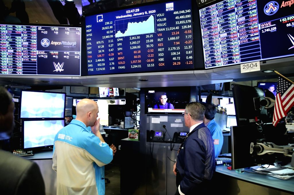 Traders watch the TV news at the New York Stock Exchange in New York, the United States, on Jan. 8, 2020. U.S. stocks finished higher on Wednesday as market fears ...