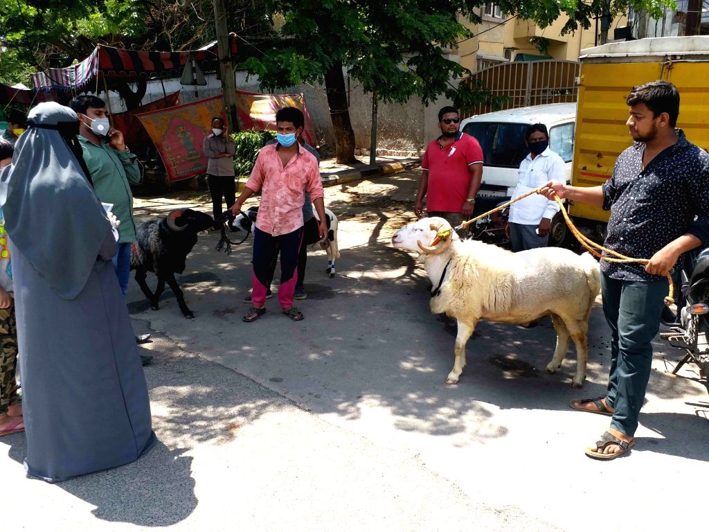 Traders with their sheeps at a livestock market ahead of Eid-Ul-Adha celebrations, in Hyderabad on July 30, 2020.