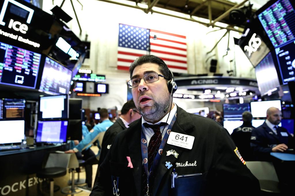 Traders work at the New York Stock Exchange in New York, the United States, on Jan. 8, 2020. U.S. stocks finished higher on Wednesday as market fears were partly ...