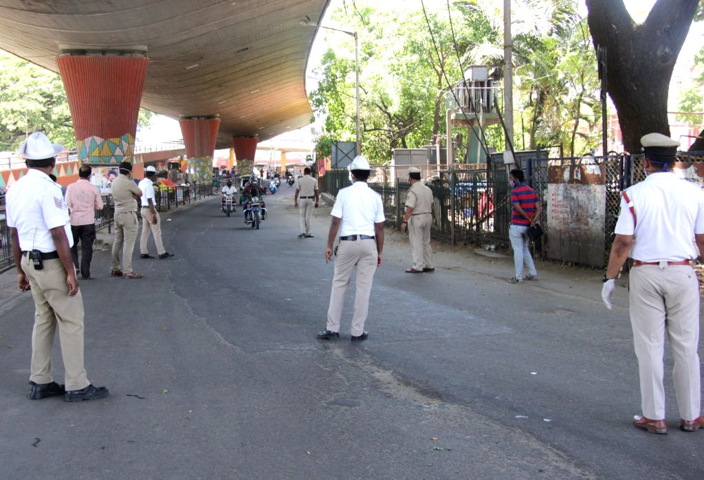 Traffic and police personnel conduct checking and intercept curfew violaters on Day 6 of the 21-day countrywide lockdown imposed to contain the spread of novel coronavirus, in Bengaluru on ...