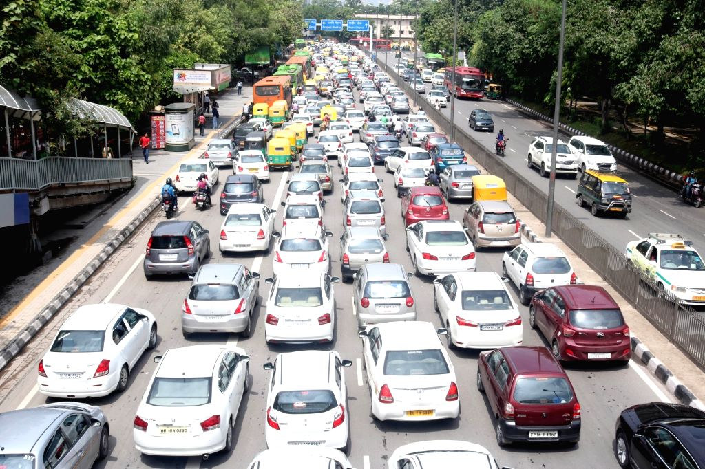 Traffic jam at different part of city after heavy downpour in New Delhi, on July 18, 2016.