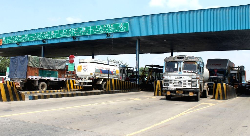 Traffic moves smoothly as Goods and Services Tax (GST) came into effect from midnight abolishing Octroi at NH-2 tollway plaza near Mathura on July 1, 2017.