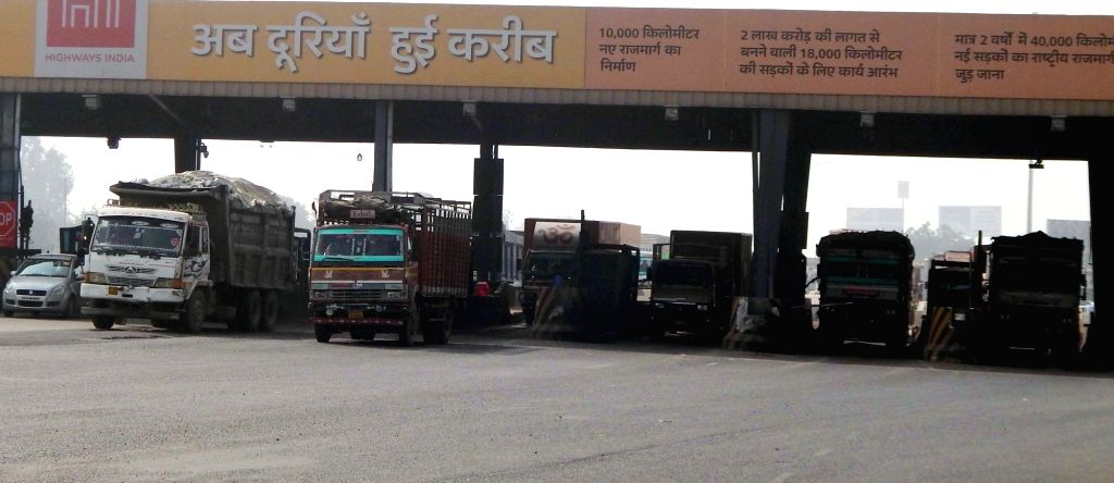 Traffic moves smoothly as Goods and Services Tax (GST) came into effect from midnight abolishing Octroi at toll plaza of Delhi- Gurugram expressway on July 1, 2017.