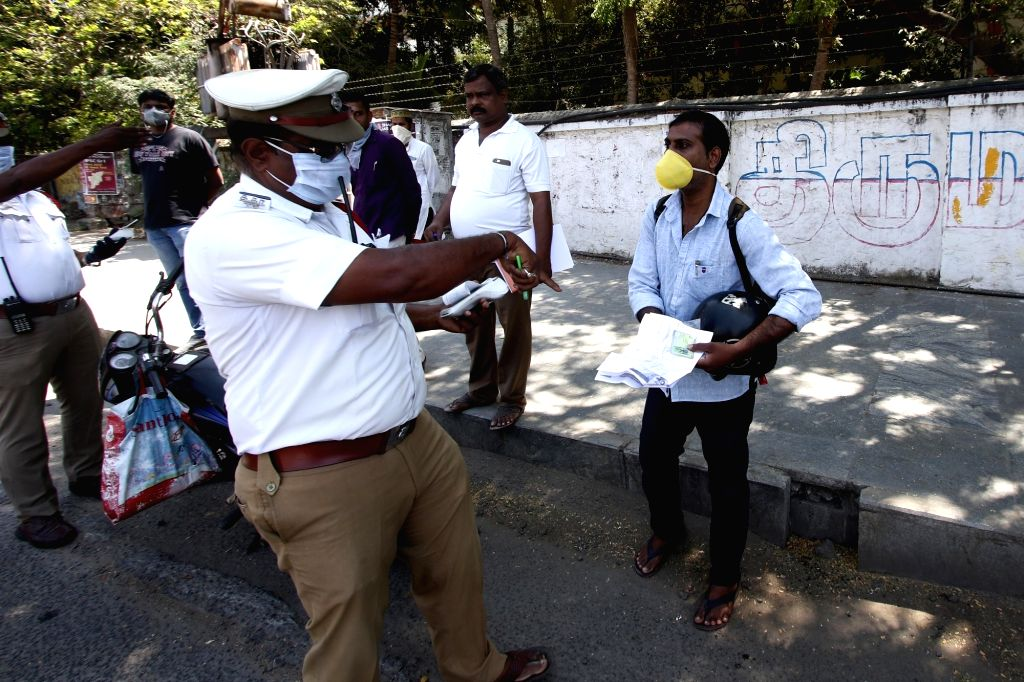 Traffic police detains vehicles of curfew violaters on Day 6 of the 21-day countrywide lockdown imposed to contain the spread of novel coronavirus, in Chennai on March 30, 2020.