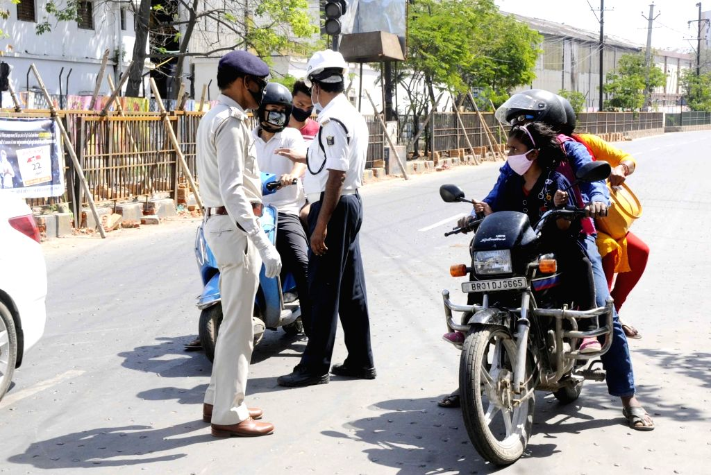 Traffic police personnel conducting checks and intercepting violaters on Day 5 of the 21-day countrywide lockdown imposed to contain the spread of novel coronavirus, in Patna on March 29, 2020.