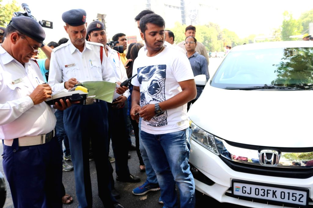 Traffic Police prosecute driver of a car with even numbered registration plate on Day 1 (Phase 2) of implementation of Delhi Government's odd-even traffic formula on April 15, 2016.