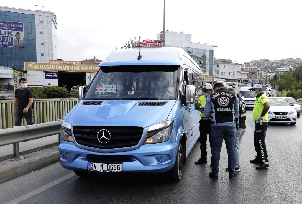 Traffic policemen check a public transport vehicle at a checkpoint in Istanbul, Turkey, on July 8, 2020. Turkey on Wednesday launched a nationwide inspection of the ...