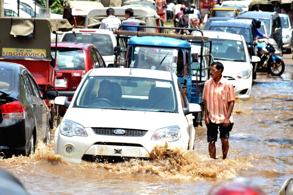 Traffic slowed down as roads get waterlogged after heavy showers in Guwahati on Aug 8, 2014.