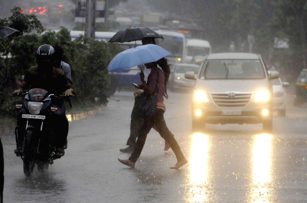 Traffic slows down in Bangalore after heavy rains in Bangalore on July 10, 2014.