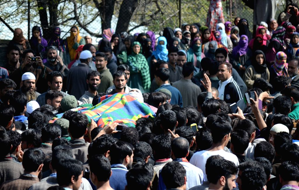 People in large numbers participate in the funeral of Khalid Muzaffar, who was killed in an army operation in forest area of Tral, Jammu and Kashmir on April 14, 2015.