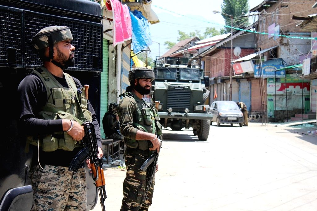 Tral: Security beefed up after authorities announced curfew in Tral town of Pulwama district on the eve of second death anniversary of Hizbul commander Burhan Wani, on July 7, 2018. (Photo: IANS)