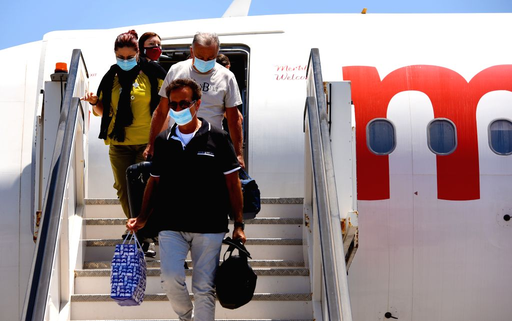 Travelers arrive at Malta International Airport in Luqa, Malta, July 1, 2020. Malta International Airport reopened on Wednesday after closure because of COVID-19 ...