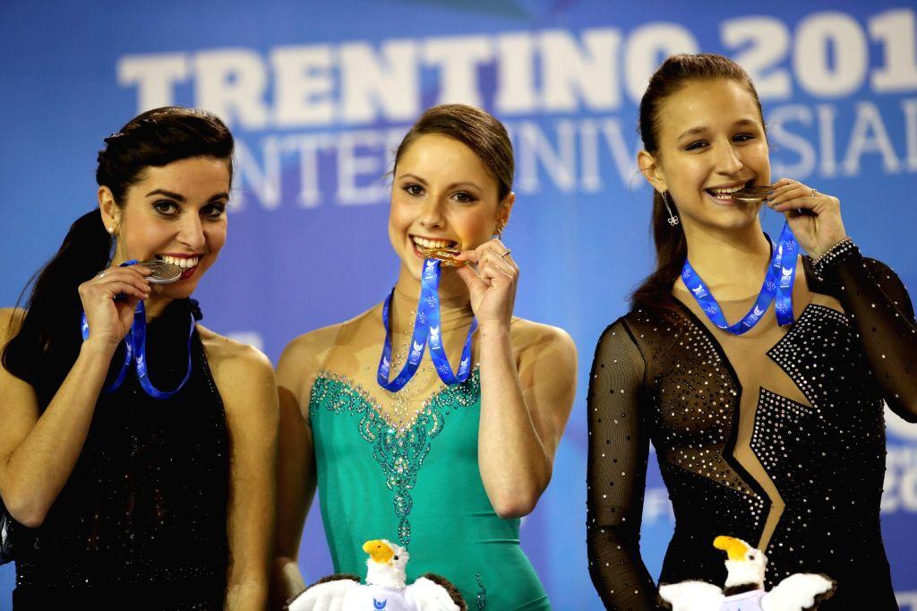 Gold medalist Sofia Biryukova (C) of Russia, silver medalist Valentina Marchel (L) of Italy and bronze medalist Sofia Mishina of Russia pose on the podium ...