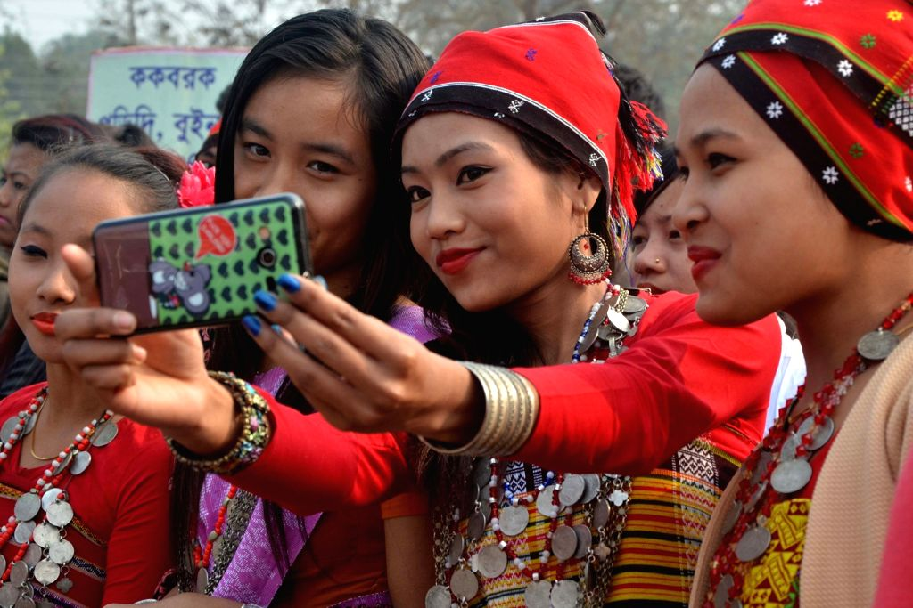 Tribal girls take a selfie in their traditional attire during a cultural procession organised on the 38th Kokborok Day in Agartala on Jan 19, 2016.