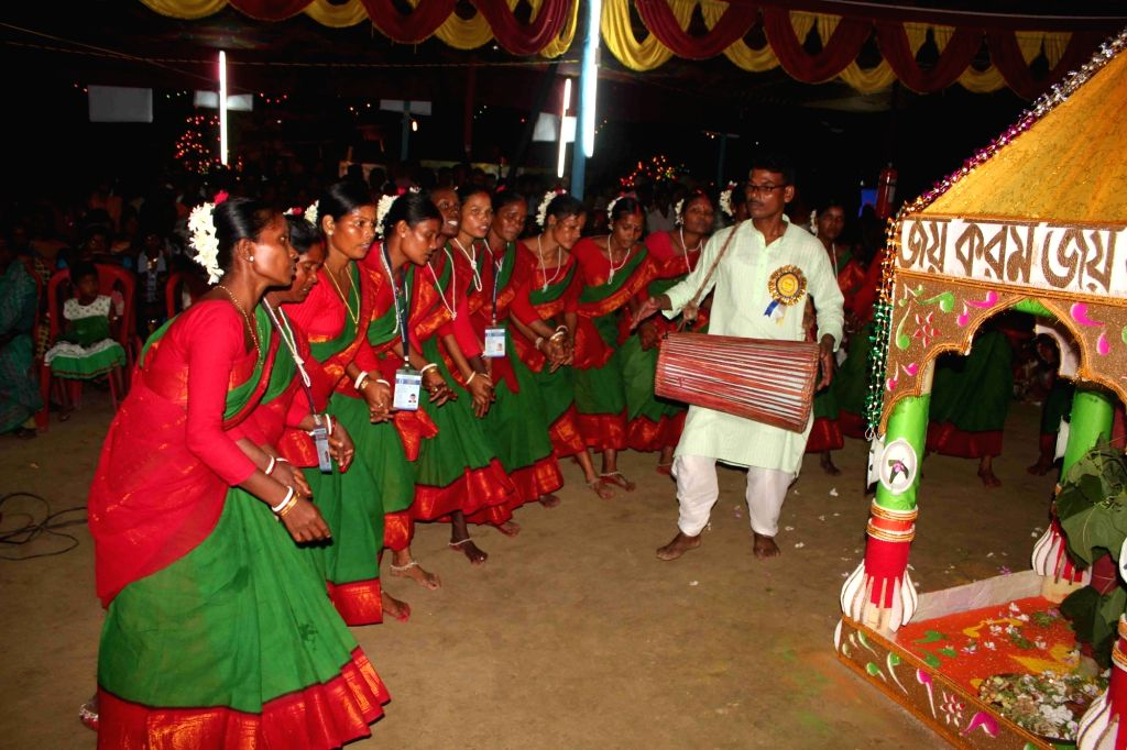 Tribals celebrate Karam festival in Badalpur village near Balurghat, West Bengal on Sept 13, 2016. Karam - an agricultural festival celebrated in India.