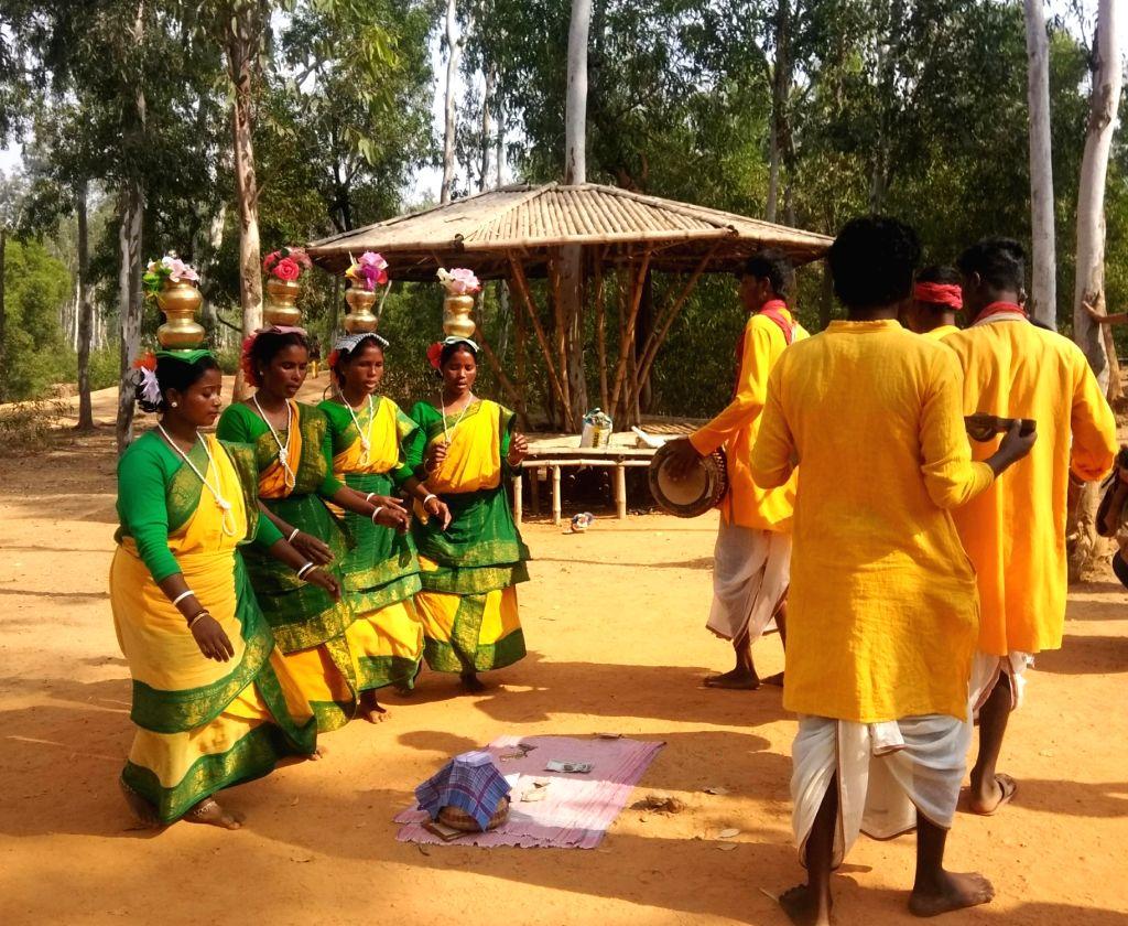 Tribals dance at a local market in Sonajhuri forest near Shantiniketan, West Bengal on Dec 10, 2018.