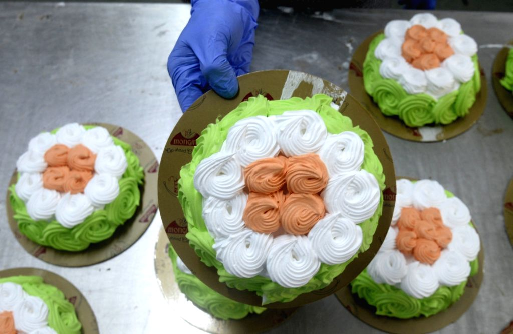 Tricolored cakes being prepared at a confectionary shop on the eve of the 74th Independence Day, in Kolkata on Aug 14, 2020.
