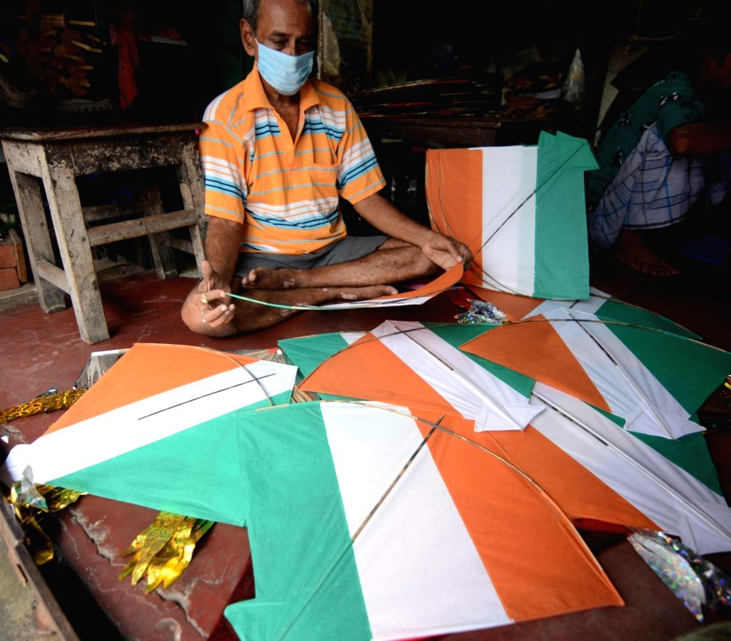 Tricolored kites up for sale at a shop ahead of Independence Day celebrations, in Kolkata on Aug 13, 2020.