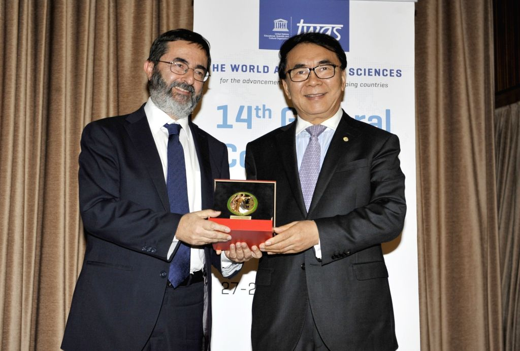 TRIESTE, Nov. 28, 2018 - Bai Chunli(R), president of the World Academy of Sciences (TWAS) and president of the Chinese Academy of Sciences, hands a medal to a scientist on the 28th TWAS general ...
