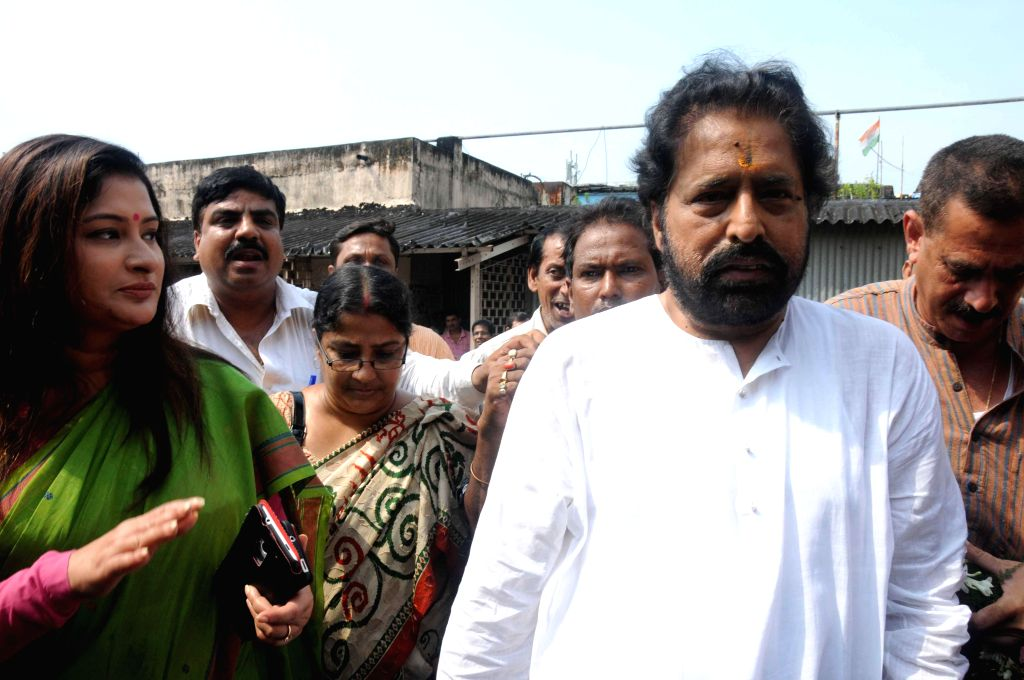 Trinamool Congress candidate from Chowringhee assembly constituency,  Nayna Banerjee and party leader Sudip Bandyopadhyay arrive to file Banerjee's nomination papers for upcoming by-polls in Kolkata .