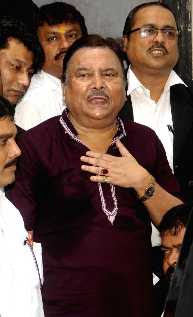 Trinamool Congress leader Madan Mitra being taken to be produced before a Kolkata court in connection with  Saradha chit fund scam in Kolkata, on June 27, 2016.