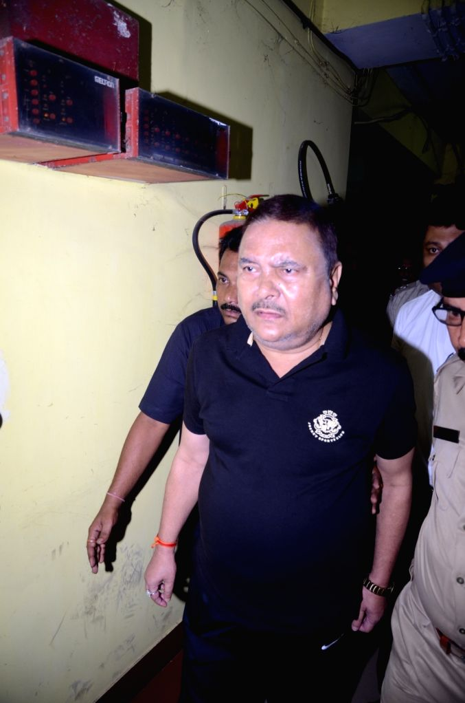 Trinamool Congress leader Madan Mitra comes out after appearing before CBI in Kolkata, on Sept 16, 2016.