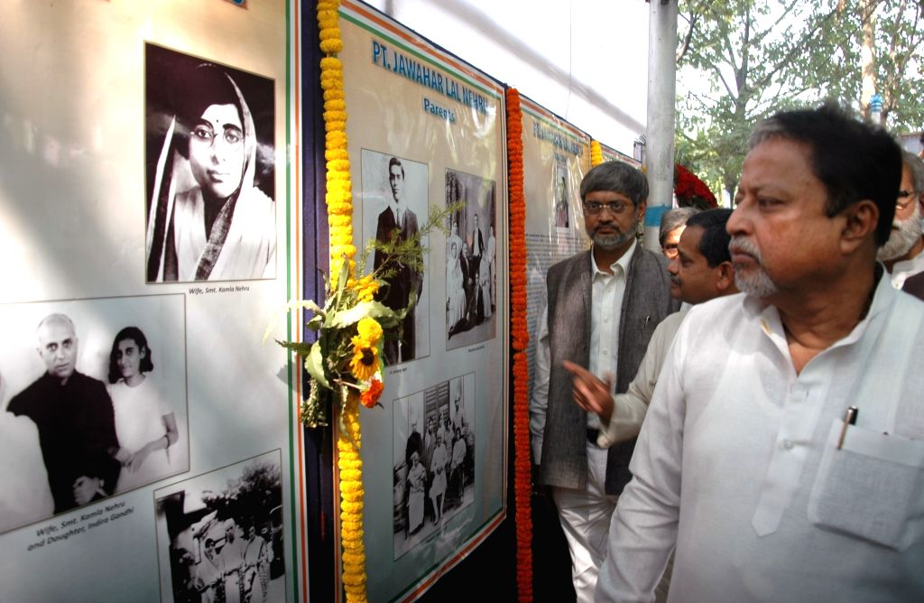 Trinamool Congress leader Mukul Roy and Congress MP Abhijit Mukherjee during a programme organised to pay tribute to former Prime Minister Pandit Jawaharlal Nehru on his 126th birth ... - Pandit Jawaharlal Nehru, Mukul Roy and Abhijit Mukherjee