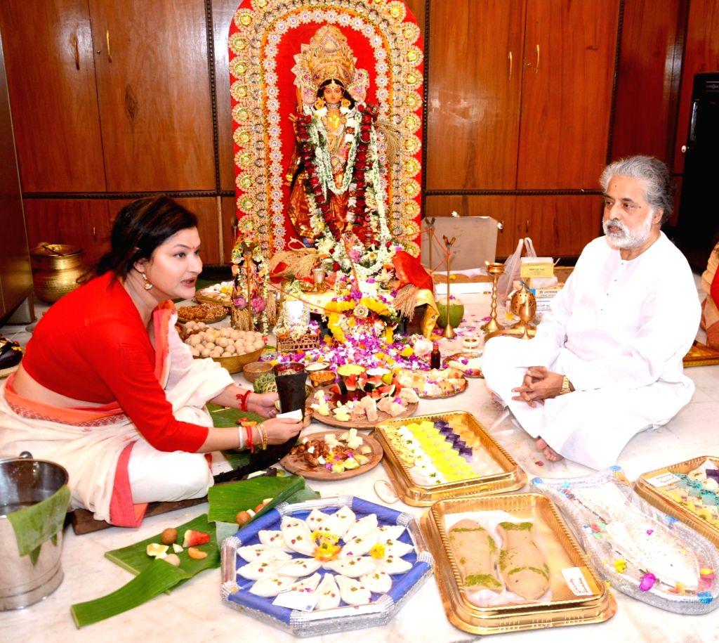 Trinamool Congress leader Sudip Bandyopadhyay and Nayna Bandyopadhyay during Laxmi Puja at their residence in Kolkata, on Oct 5, 2017.