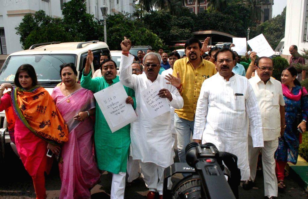 Trinamool Congress legislators stage a demonstration against US Government in Kolkata on March 6, 2017.