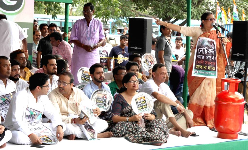 Trinamool Congress (TMC) activists stage a demonstration against hike in the prices of petrol and diesel, in Kolkata on May 29, 2018.