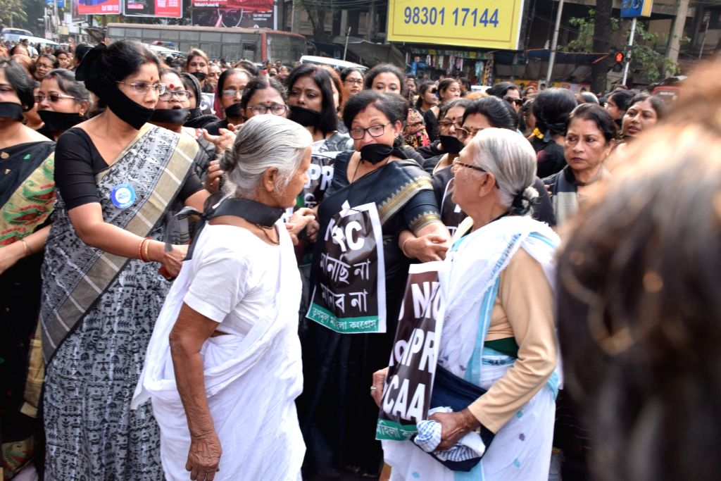 Trinamool Congress (TMC) activists stage a demonstration against the Citizenship Amendment Act (CAA) 2019, National Register of Citizens (NRC) and National Population Register (NPR), in ...