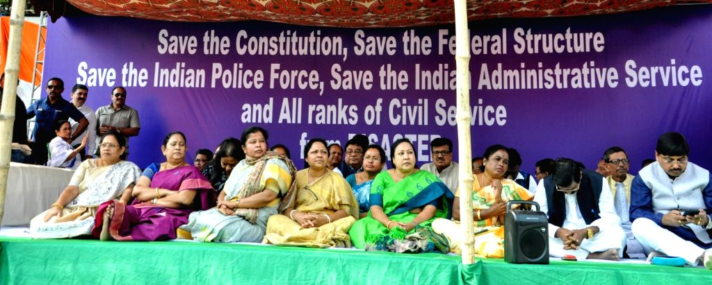Trinamool Congress (TMC) leaders participate in a sit-in (dharna) protest over the CBI's attempt to question Kolkata Police Commissioner Rajeev Kumar in connection with a ponzi scheme scam, ...