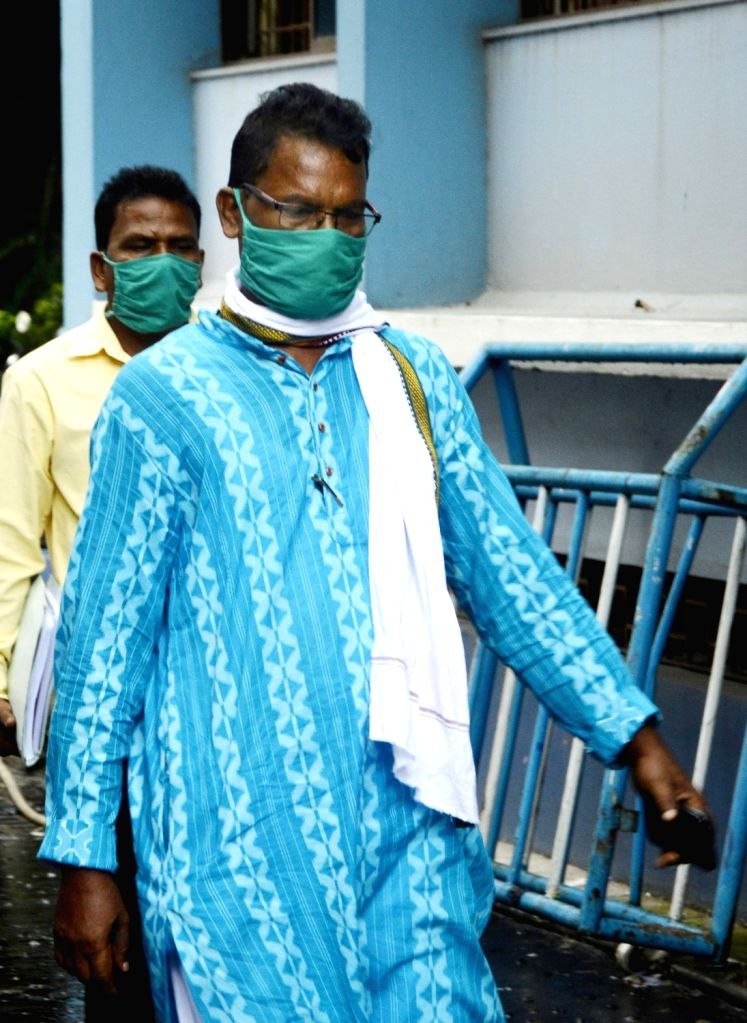 Trinamool Congress (TMC) State Secretary Chhatradhar Mahato being produced at the Bankshall Court by NIA officials in connection with the re-investigation into the killing of CPI-M activist ...