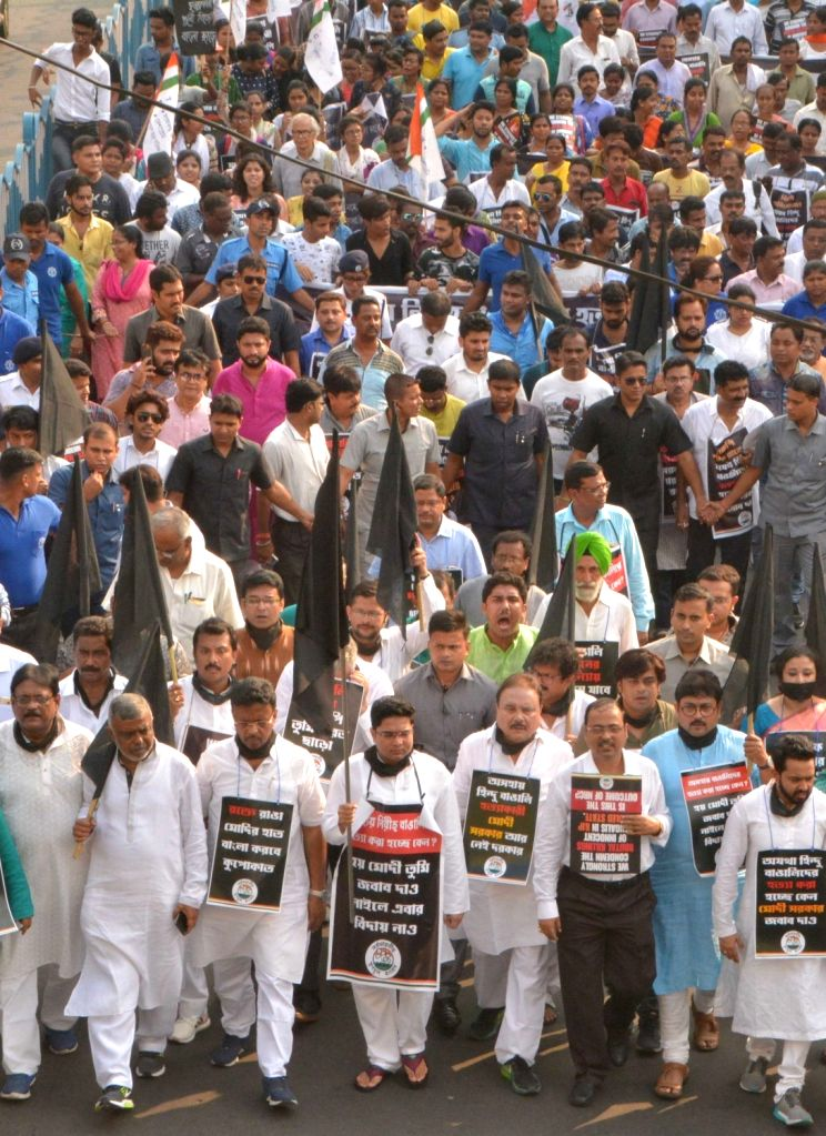 Trinamool Congress (TMC) workers led by Abhishek Banerjee stage a protest march against killing of five persons by militants in Kherbari of Assam's Tinsukia district; in Guwahati on Nov 2, ... - Abhishek Banerjee