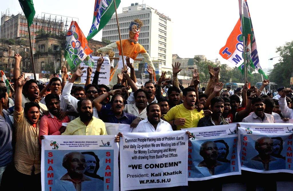 Trinamool Congress (TMC) workers participate in a protest march against demonetisation in Kolkata on Nov 22, 2016.