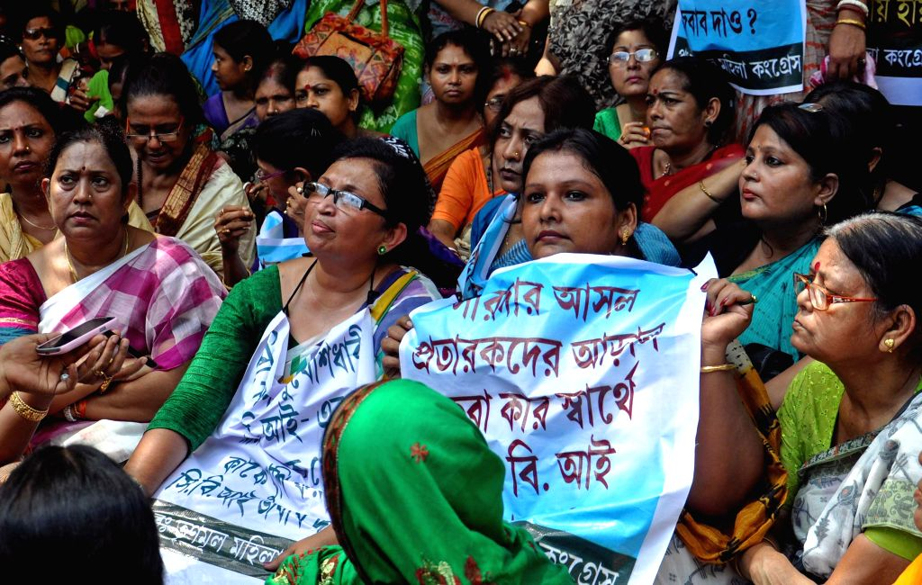 Trinamool Congress workers led by West Bengal Law Minister Chandrima Bhattacharya, Chairperson of Bidhannagar Municipality Krishna Chakraborty and others protest against CBI in Kolkata on Sept 11, ... - Chandrima Bhattacharya