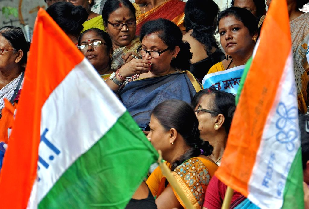 Trinamool Congress workers led by West Bengal Law Minister Chandrima Bhattacharya protest against CBI in front of CGO complex in Kolkata on Sept 12, 2014. - Chandrima Bhattacharya