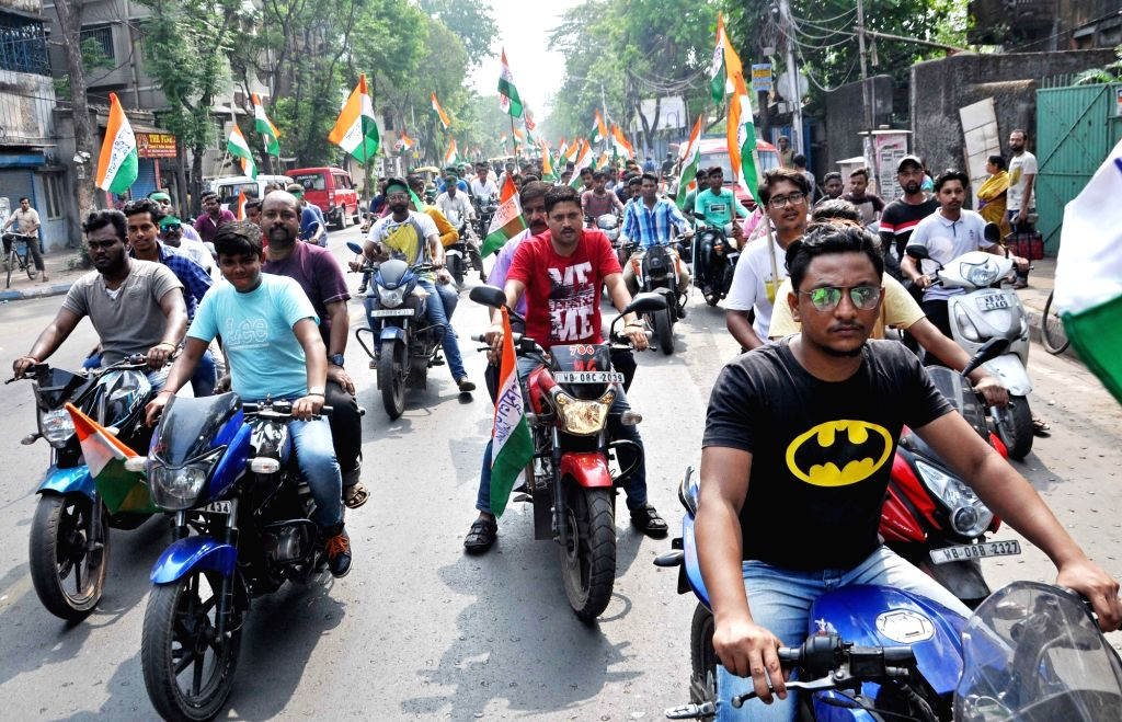 Trinamool Congress workers participate in a bike rally organised on Ram Navami in Kolkata, on March 25, 2018.