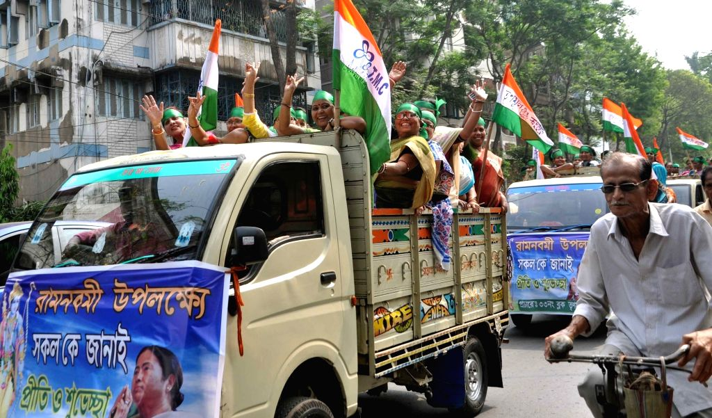 Trinamool Congress workers participate in a rally organised on Ram Navami in Kolkata, on March 25, 2018.