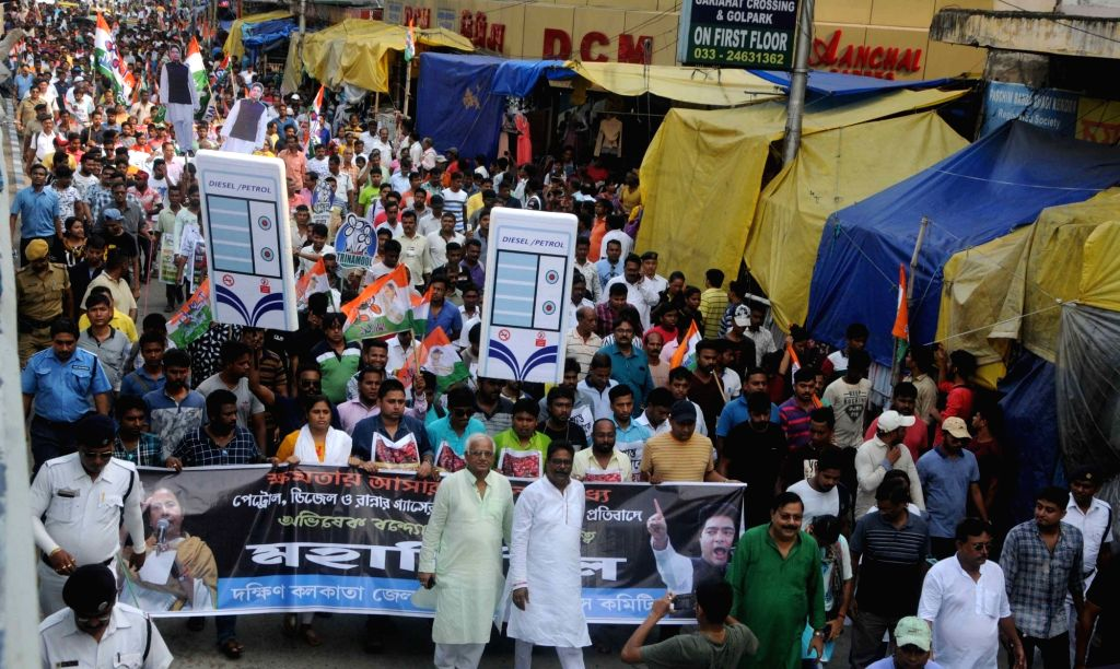 Trinamool Congress workers stage a demonstration against hike in fuel prices in Kolkata on June 4, 2019.