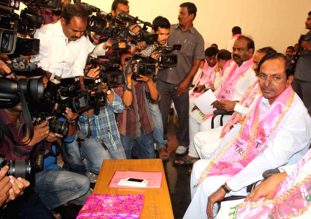 Trinomol Congress Guwahati Lok Sabha seat candidate and veteran actor Biju Phukan (L) addressing a press conference regarding the upcoming 3rd phase Lok Sabha elections in Guwahati on April 12, 2014.