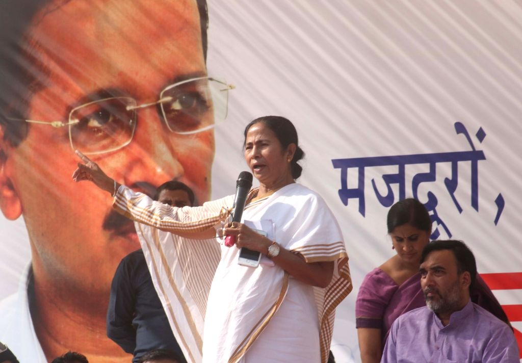 Trinomool Congress supremo and West Bengal Chief Minister Mamata Banerjee addresses during a public meeting to protest against demonitisation by central government at Azadpur Mandi in New ... - Mamata Banerjee