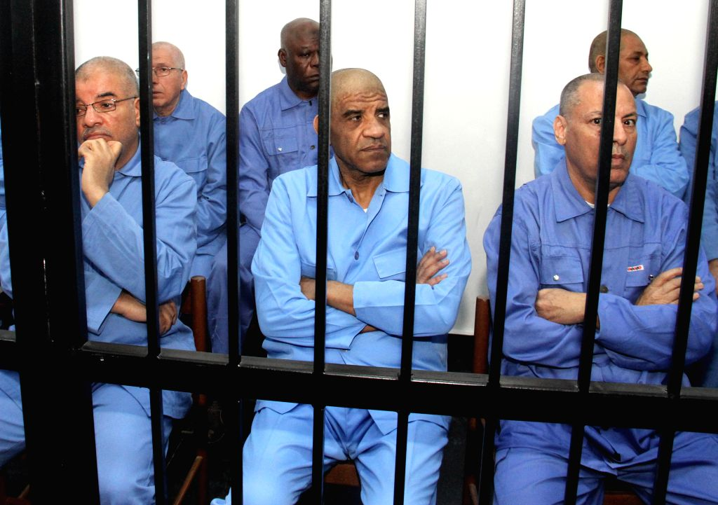 Former intelligence chief Abdullah al-Senussi (C) is seen in an appeals court in Tripoli, capital of Libya, on April 20, 2015. The court on Monday adjourned until ...