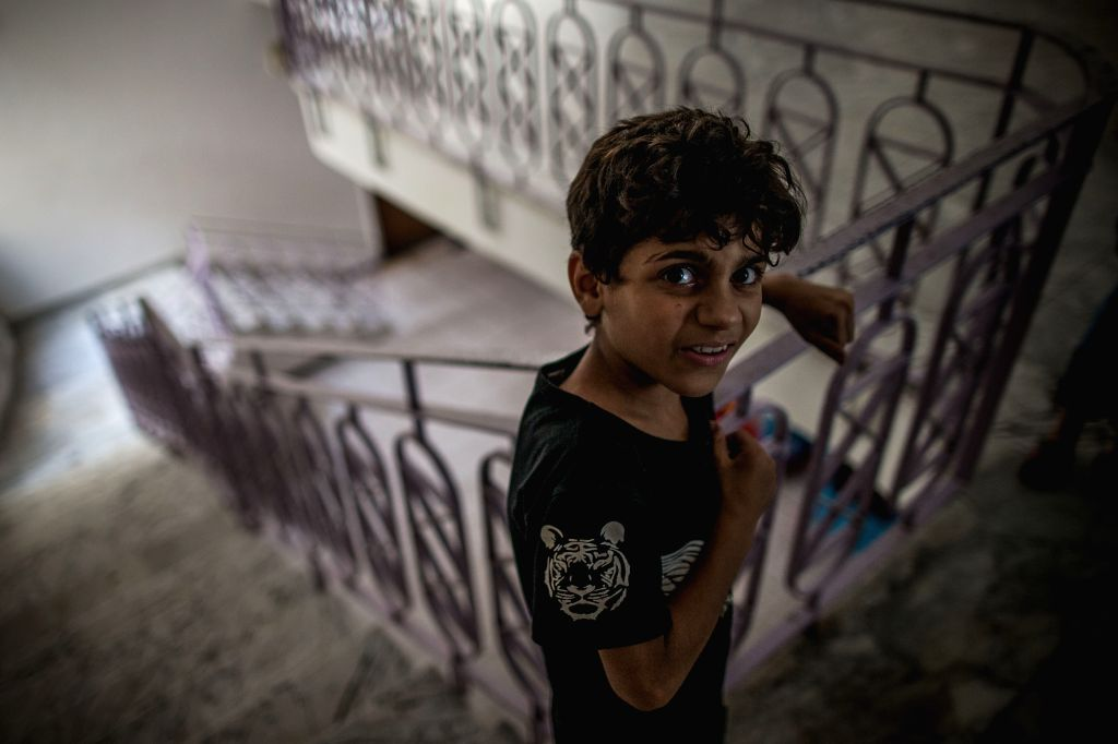 TRIPOLI, Aug. 10, 2019 - A displaced boy is seen in an abandoned dispensary in Tripoli, Libya, on Aug 10, 2019. According to the United Nations Higher Commission of Refugees (UNHCR), armed conflict ...
